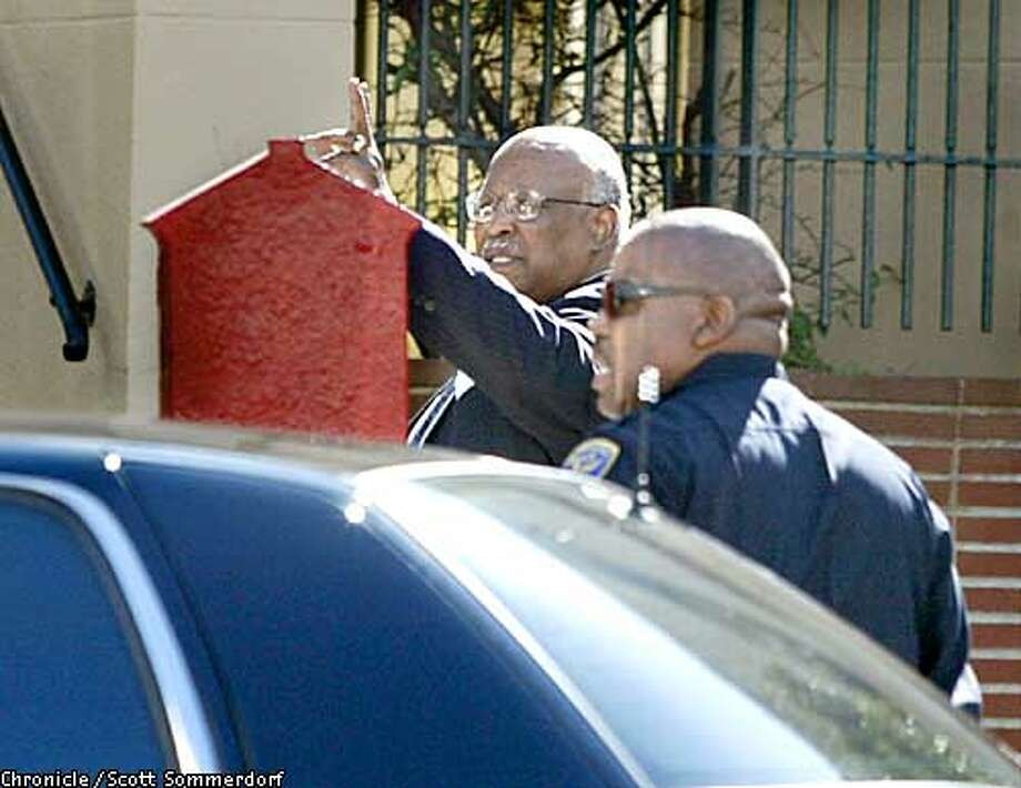 SF Chief of Police, Earl Sanders waves to a well-wisher as he arrives at Third Baptist Church at Pierce and McAllister in San Francisco, Sunday, March 2nd, 2003. SF CHRONICLE PHOTO BY SCOTT SOMMERDORF