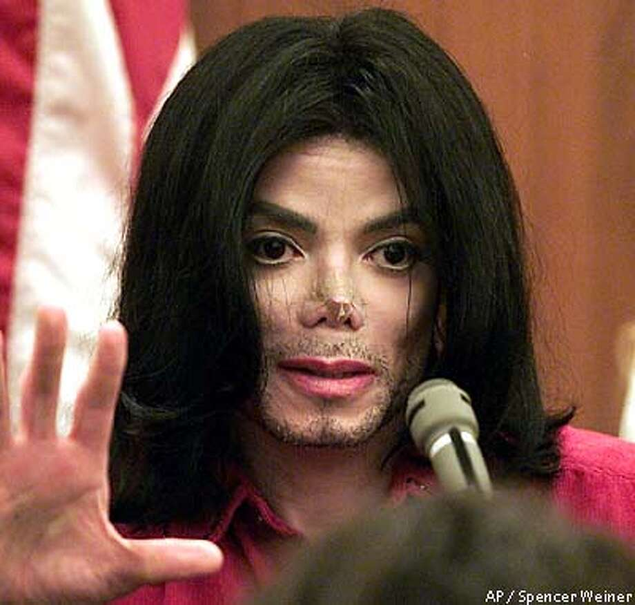 Michael Jackson testifies in Santa Maria Superior Court, November 13, 2002 in trial in which he is accused of cancelling scheduled concert appearances, costing his promoter several million (AP Photo/Spencer Weiner/Los Angeles Times pool) Photo: SPENCER WEINER