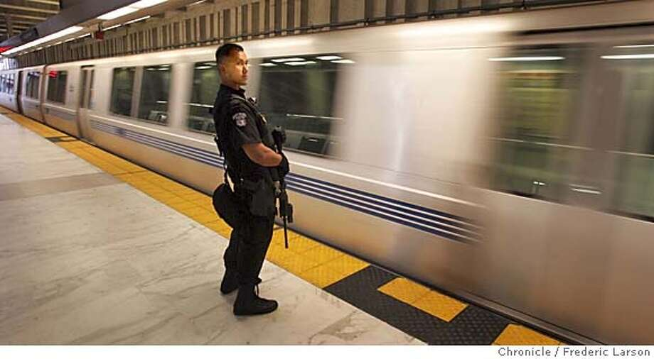BARTSWAT_432_fl.jpg BART SWAT team member Sgt. Eugene Wong make a sweeps through different BART lines San Francisco. BART police SWAT teams have started to patrol the system in full gear and M-16 rifles, serving as a high-visibility deterrent to terrorists between now and election day. 10/22/04 San Francisco CA Frederic Larson The San Francisco Chronicle Ran on: 10-23-2004  BART rider Stefan Rohner watches two members of a SWAT team that now patrols the system's trains carrying assault weapons. Ran on: 10-23-2004  BART rider Stefan Rohner watches two members of a SWAT team that now patrols the system's trains carrying assault weapons. Photo: Frederic Larson
