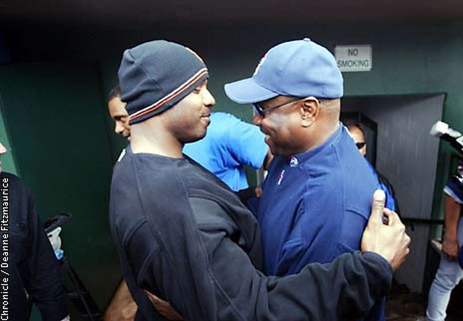 Dusty Baker came up to greet Barry Bonds in the Cubs dugout and they hugged. Baker brought his Chicago Cubs to Scottsdale Stadium to play his former team the San Francisco Giants for the first spring training game. The game was eventually called a rain out but not until after Baker was reunited with many of his former players and team personnel.  CHRONICLE PHOTO BY DEANNE FITZMAURICE Photo: Deanne Fitzmaurice