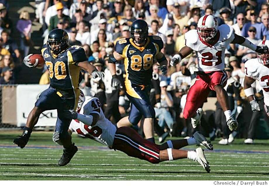 biggame_007_db.jpg  California Golden Bears J.J. Arrington runs for a large gain in the 2nd qtr. vs. Stanford Cardinals Brandon Harrison (46) tries to tackle and Oshiomogho Atogwe (21) pursues football Big Game at Memorial Stadium. 11/20/04 in Berkeley  Darryl Bush / The Chronicle MANDATORY CREDIT FOR PHOTOG AND SF CHRONICLE/ -MAGS OUT Photo: Darryl Bush