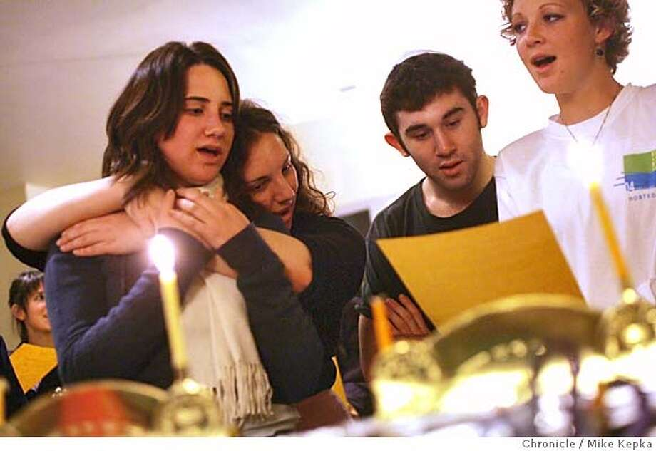 hanukkah0025_mk.jpg UC Berkeley students, Michelle Vaysberg, Elizabeth Aronson, Ethan Davidoff and Lani Bloom sing Maoz Tzur as the candle on the menorah is lit at Berkeley Hillel on the first night of Hannukah. Berkeley Hillel will have a lighting ceremony at 6pm for for the remaining nights of Hannukah with the exception of Friday which is at 8:30 p.m. 12/7/04  Mike Kepka/The Chronicle MANADATORY CREDIT FOR PHOTOG AND SF CHRONICLE/ -MAGS OUT Photo: Mike Kepka