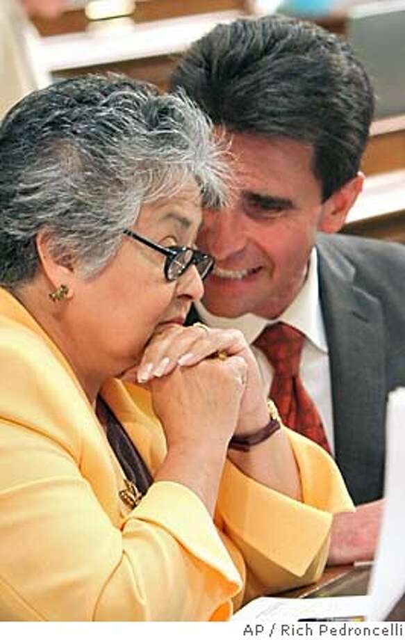 Assemblyman Mark Leno, D-San Francisco, right, talks with Assemblywoman Gloria Negrete McCleod, D-Chino, who failed to vote for Leno's gay marriage bill during the Assembly session at the Capitol in Sacramento, Calif., Wednesday, June 1, 2005. McCleod was one of several Democrats who did not cast a vote on the measure, which failed to pass by a 35-37 vote. Leno put the bill on hold while he tried to get the votes needed for passage. (AP Photo/Rich Pedroncelli) Photo: RICH PEDRONCELLI
