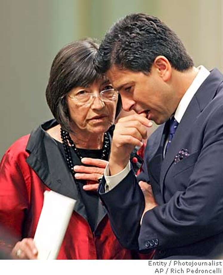 Assemblywoman Patti Berg, D-Eureka, left, confers with Assembly Speaker Fabian Nunez, D-Los Angeles, during a day long Assembly session held at the Capitol, in Sacramento, Calif., Wednesday, June 1, 2005. Short of votes and facing a looming deadline, the authors of a bill to allow doctor-assisted suicide suspended their efforts in the Assembly on Wednesday and shifted their focus to the state Senate. (AP Photo/Rich Pedroncelli) Photo: RICH PEDRONCELLI