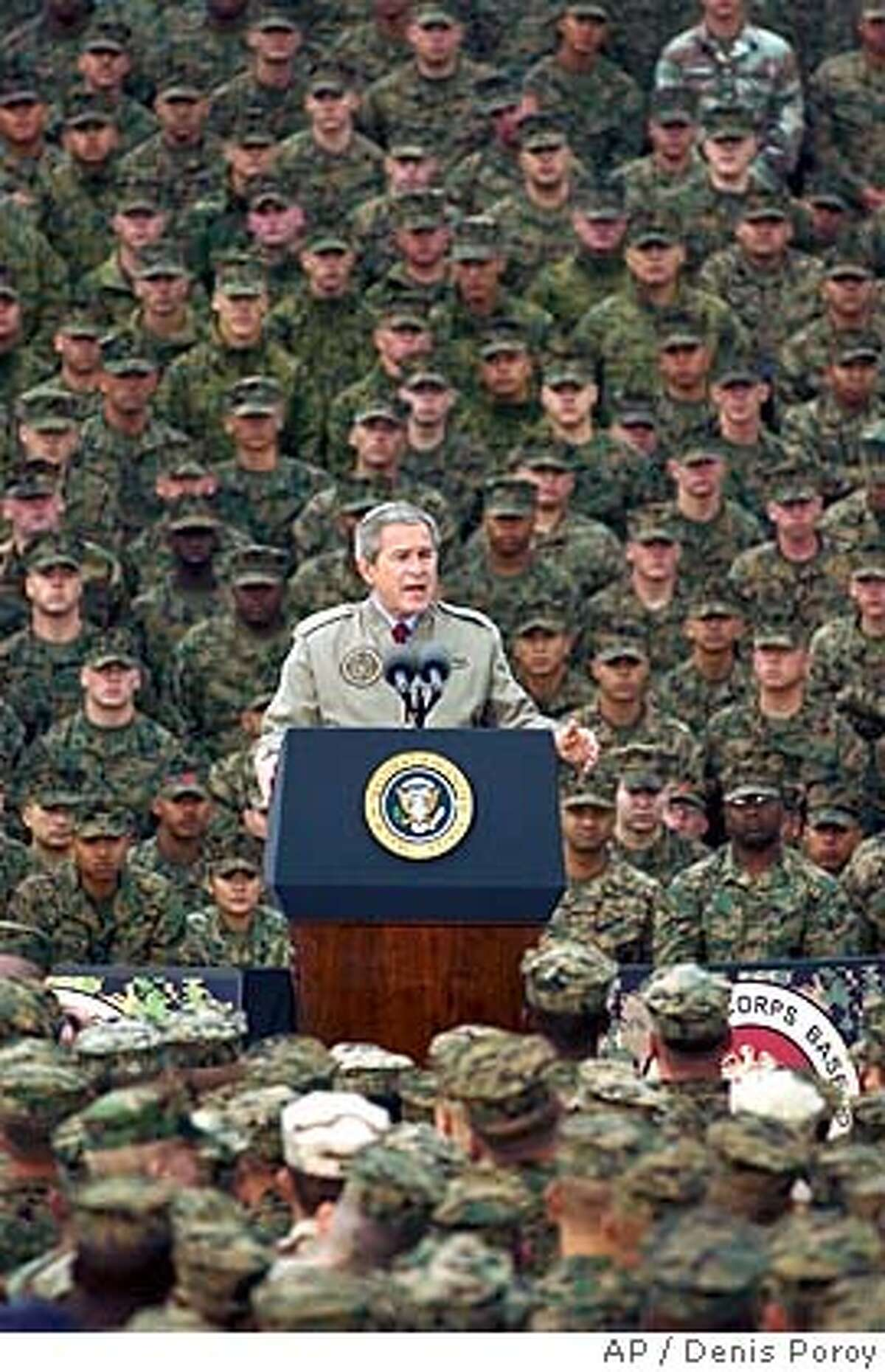 President Bush speaks to Marines during a visit to Camp Pendleton Marine Corps Base in San Diego Tuesday, Dec. 7, 2004. (AP Photo/Denis Poroy) RETRANSMISSION FOR IMPROVED QUALITY