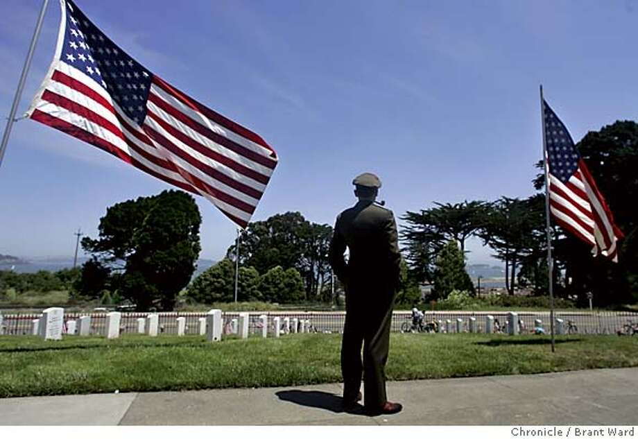 memorial689_ward.jpg  John Stokes struck a pose his grandfather would be proud of as he looked north towards the bay. John wore his grandfather's US Army Air Corp uniform to Memorial Day services to honor his memory Monday.  Memorial Day ceremonies were held once again at the San Francisco National Cemetery at the Presidio. Pleasant weather helped bring out about 2000 people to this years event. The cemetery measures about 27 acres and contains over 30,000 graves.  Brant Ward 5/31/05 Photo: Brant Ward