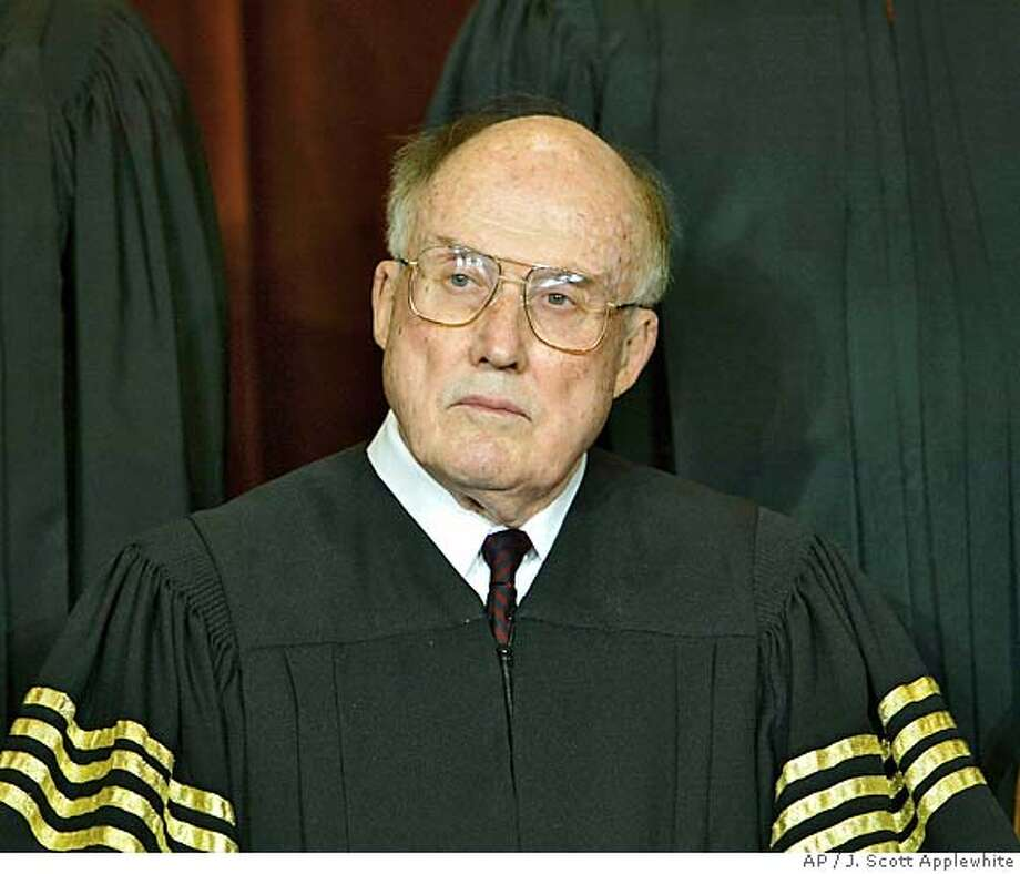 ** FILE ** Chief Justice of the United States William H. Rehnquist sits for a formal group photo session with the members of the U.S. Supreme Court, at the Supreme Court Building in Washington, in this file photo dated Dec. 5, 2003. At age 80, Rehnquist's health remains shrouded in mystery with the extent of his thyroid cancer a closely guarded secret since his illness was made public Oct. 25, 2004. (AP Photo/J. Scott Applewhite/File) FILE PHOTO DEC 5, 2003 Photo: J. SCOTT APPLEWHITE