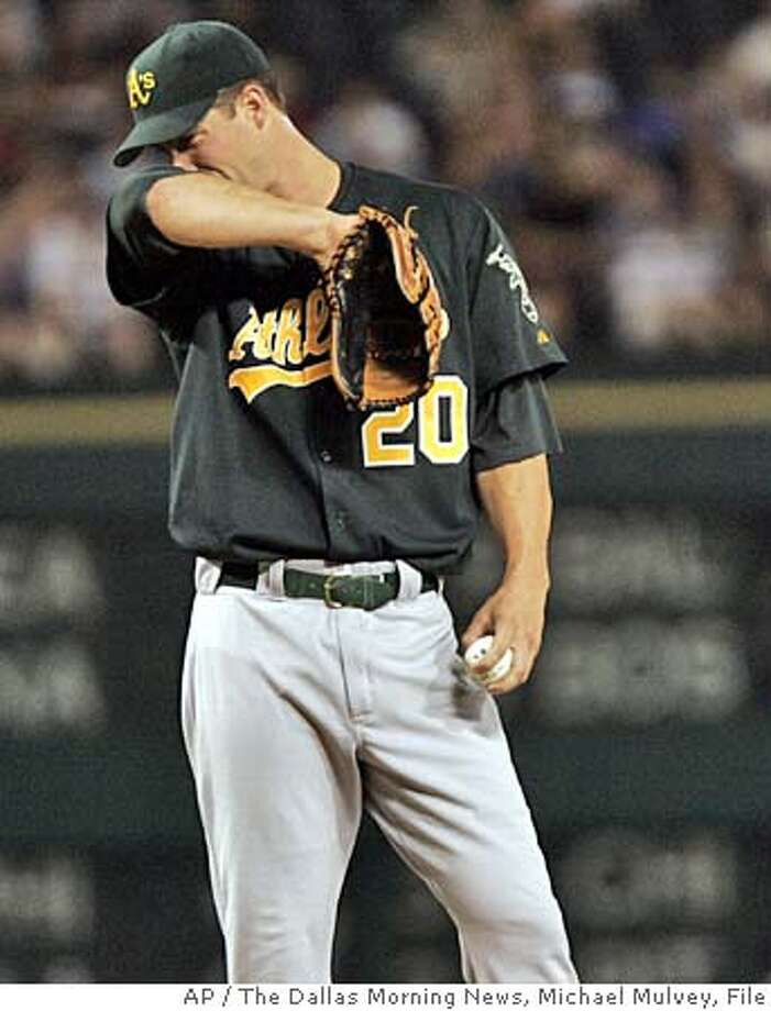 Oakland Athletics pitcher Mark Mulder wipes his brow after he hit Texas Rangers' Mark Teixeira during the third inning Tuesday, Sept. 21, 2004, in Arlington, Texas. The Rangers won 9-4. (AP Photo/The Dallas Morning News, Michael Mulvey) Ran on: 09-22-2004  Mark Mulder is 0-2 with an 8.22 ERA in September. MANDATORY CREDIT: THE DALLAS MORNING NEWS, , MAGS OUT, TV OUT, INTERNET OUT Sports#Sports#Chronicle#12/5/2004#ALL#5star##0422366800 Photo: MICHAEL MULVEY