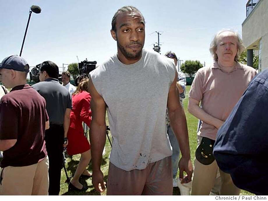 49ers_076_pc.jpg  Linebacker Julian Peterson, who appeared in the video as a panhandler, heads for the locker room after a brief news conference. San Francisco 49ers players and staff comment on the controversial training video at the team's headquarters on 6/1/05 in Santa Clara, Calif.  PAUL CHINN/The Chronicle MANDATORY CREDIT FOR PHOTOG AND S.F. CHRONICLE/ - MAGS OUT Photo: PAUL CHINN