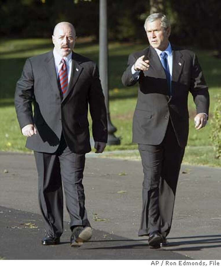 ** FILE ** President Bush walks with former New York City Police Commissioner Bernard Kerik, left, in this Oct. 3, 2003 file photo on the South Lawn of the White House. Kerik has been named as the President's choice to replace Tom Ridge as the Secretary of Homeland Security, a senior administration official said Thursday, Dec. 2, 2004. (AP Photo/Ron Edmonds, File) Photo: RON EDMONDS