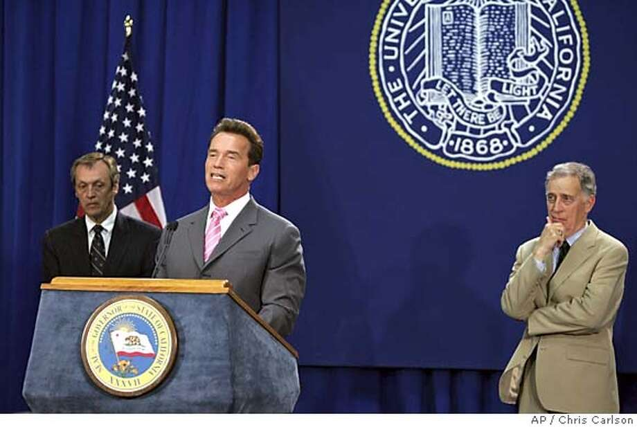 California Gov. Arnold Schwarzenegger, center, talks about a new program that would quadruple the number of math and science teachers trained by the University of California over the next five years as Robert Dynes, UC president, left, and , Ralph Cicerone, UCI chancellor, look on Tuesday, May 31, 2005, at the UC, Irvine campus, in Irvine, Calif. (AP Photo/Chris Carlson) Photo: CHRIS CARLSON