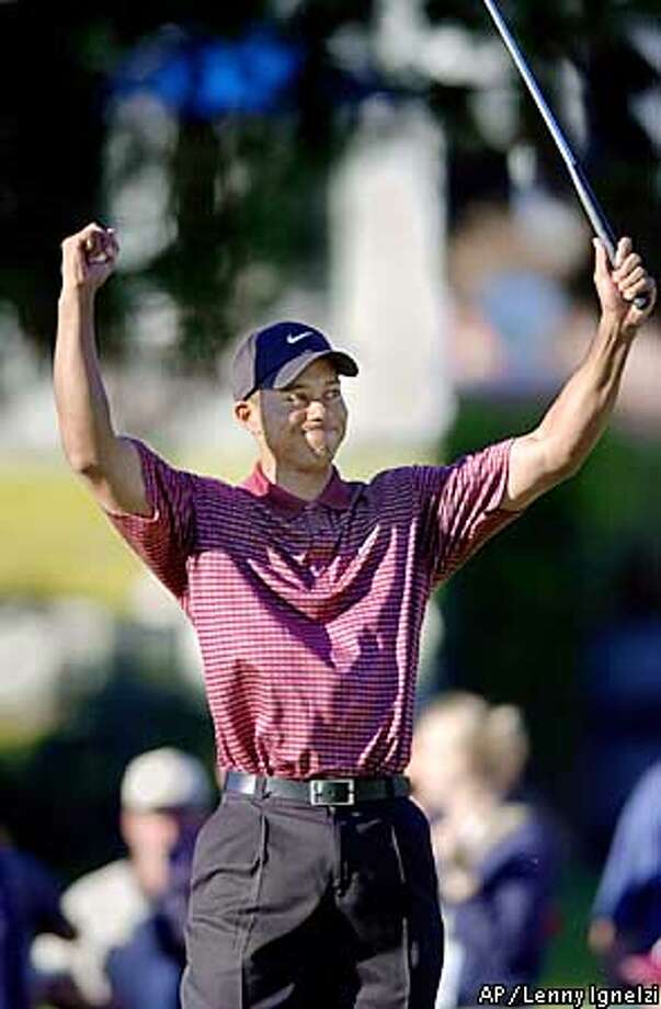 Tiger Woods celebrates his 2 and 1 victory over David Toms in the final match of the Accenture Championship at La Costa Resort in Carlsbad, Calif., Sunday, March 2, 2003. (AP Photo/Lenny Ignelzi) Photo: LENNY IGNELZI
