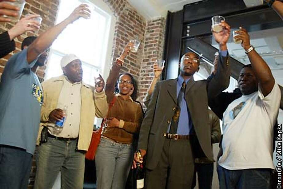 During a press conference, m,embers of the Baker Center for Human Rights in San Francisco make a toast celebrating the indictments made in the San Francisco Police department. BY MIKE KEPKA/THE CHRONICLE Photo: MIKE KEPKA