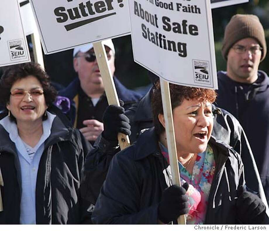 SUTTER_240_fl.jpg A one day strike on 12/1 bought about a lock-out for SEIU workers like Tine Mohi hospital staffer (right foreground) and member of local 250 (Healthcare Union) now finds herself walking the picket line with her brothers and sister in front of the entrance of Alta Bates Hospital in Berkeley.12/2/04 Berkeley CA Frederic Larson  The San Francisco Chronicle Photo: Frederic Larson