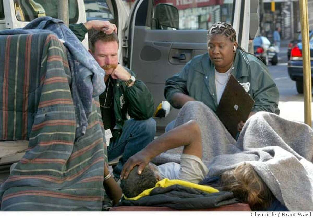 Ben Aymes, left, and Dorothy, two outreach workers who helped Ricky and Jill, listen to them on a morning in August 2004. In 2004, the city of San Francisco started to implement the Care Not Cash program. One aspect of the program was to send outreach workers into the streets to contact the chronically homeless people and try to place them in hotel rooms. On Jones Street in the Tenderloin, several homeless people were helped inside, while others proved more difficult. 9/14/04 Brant Ward