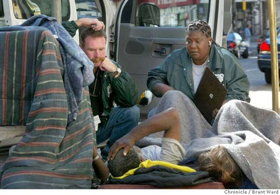 Ben Aymes, left, and Dorothy, two outreach workers who helped Ricky and Jill, listen to them on a morning in August 2004.  In 2004, the city of San Francisco started to implement the Care Not Cash program. One aspect of the program was to send outreach workers into the streets to contact the chronically homeless people and try to place them in hotel rooms. On Jones Street in the Tenderloin, several homeless people were helped inside, while others proved more difficult.  9/14/04 Brant Ward Photo: Brant Ward
