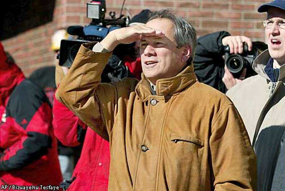 The Boston Red Sox President/CEO, Larry Lucchino watches as construction workers put the new beam up at Fenway Park in Boston Tuesday, Feb. 25, 2003, as part of the first step toward putting in 275 new seats and standing room for 100 people.(AP Photo/ Bizuayehu Tesfaye) Photo: BIZUAYEHU TESFAYE