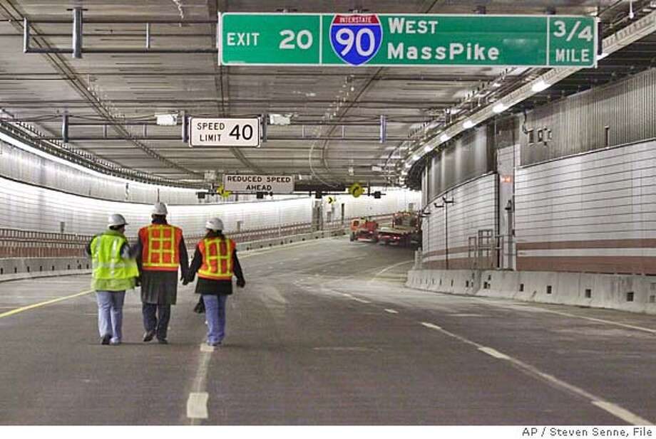 ** APN ADVANCE FOR Sunday, JAN. 18 **Three workers on the Big Dig central artery project walk through a portion of the southbound side of the I-93 tunnel in Boston, Dec. 19, 2003. The opening of the southbound tunnel marks the last major milestone for the Big Dig, which at over $14 billion, is the most expensive highway project in U.S. history. (AP Photo/Steven Senne) Three workers on the Big Dig project walk through a portion of the Interstate 93 tunnel in Boston. HFR 01-18-04. APN ADVANCE FOR SUNDAY, JAN. 18 Business#Business#Chronicle#12/3/2004#ALL#5star##0421566209 Photo: STEVEN SENNE