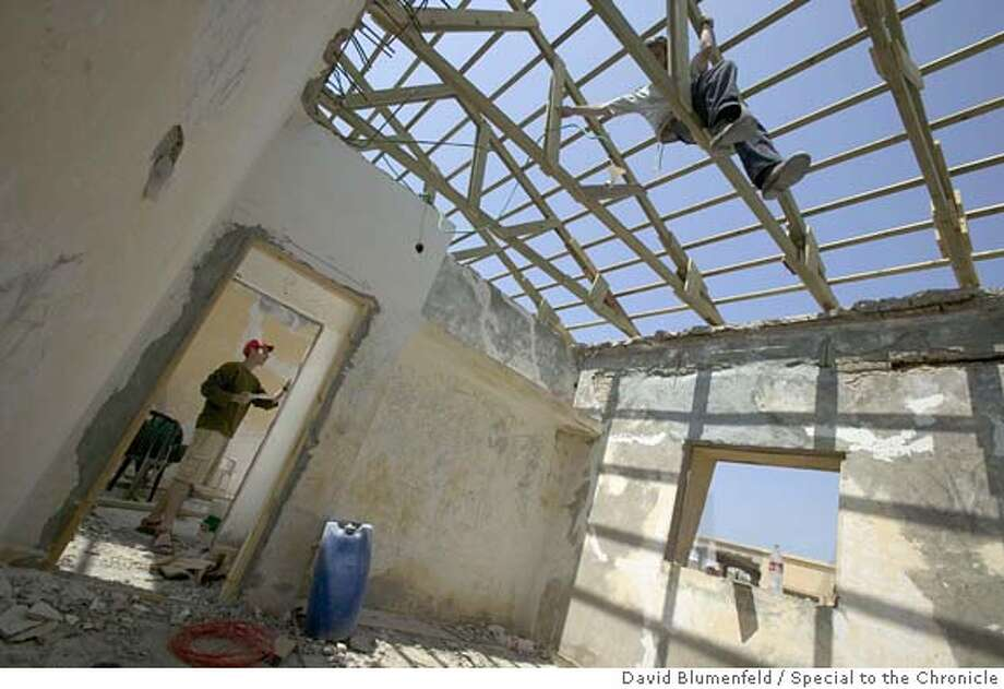 Shirat Yam, Gaza: May, 2005: Israelis renovate homes in the small beachfront Gaza settlement of Shirat Yam for families opposed to the Gaza disengagement plan to move in. The homes, once used as the residences for Egyptian officers, are being renovated 3 months before the disengagement plan takes effect.  �David Blumenfeld