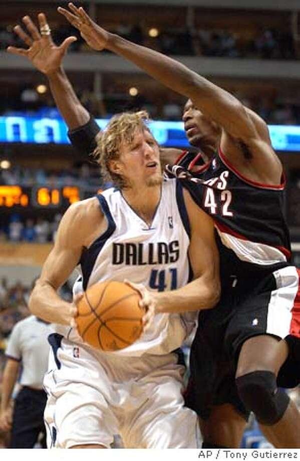 Dallas Mavericks' Dirk Nowitzki (41) of Germany, is fouled by Portland Trail Blazers;' Theo Ratliff (42) in the second half, Friday, Nov. 26, 2004, in Dallas. Nowitzki scored 23 points in the Mavericks 92-83 win. (AP Photo/Tony Gutierrez) Sports#Sports#Chronicle#12/5/2004#ALL#5star##0422486900 Photo: TONY GUTIERREZ