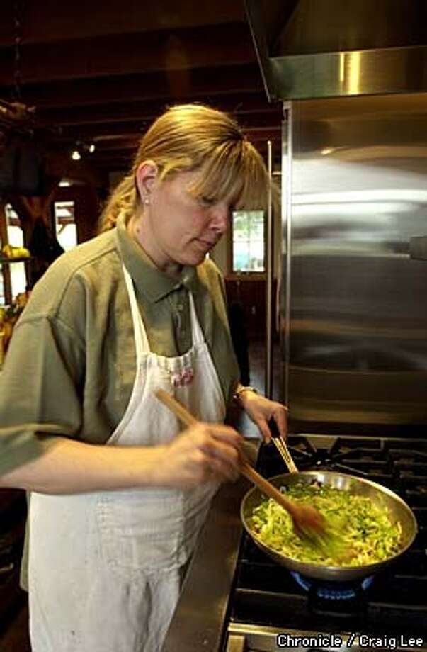 Maria Helm Sinskey, a chef, caterer, cooking teacher, her husband is wine maker Robert Sinskey. She is cooking a leek and pancetta tart, and a leek souffle. Photo of leeks being cooked in the frying pan.  Photo by Craig Lee/San Francisco Chronicle Photo: CRAIG LEE