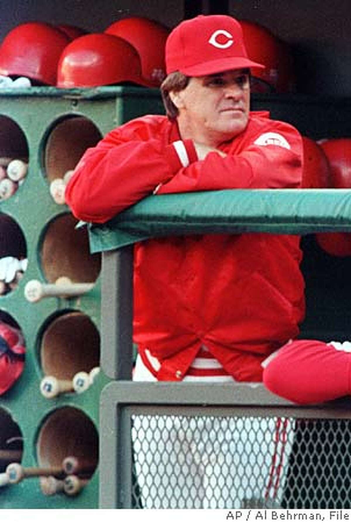 ** FILE ** Cincinnati Reds manager Pete Rose watches the action from the dugout at Riverfront Stadium in Cincinnati June 30, 1989. After 14 years of denials, Pete Rose has finally come clean and admitted he bet on baseball. Now he wants to know whether his confession will be good for anything more than his soul. Rose hopes baseball will end his lifetime ban after his first public acknowledgment that he bet on games while managing the Cincinnati Reds. He says he never bet against his own team.(AP Photo/Al Behrman) Pete Rose is baseballs career hits leader with 4,256. ProductNameChronicle Sports#Sports#Chronicle#12/4/2004#ALL#5star##0421555803