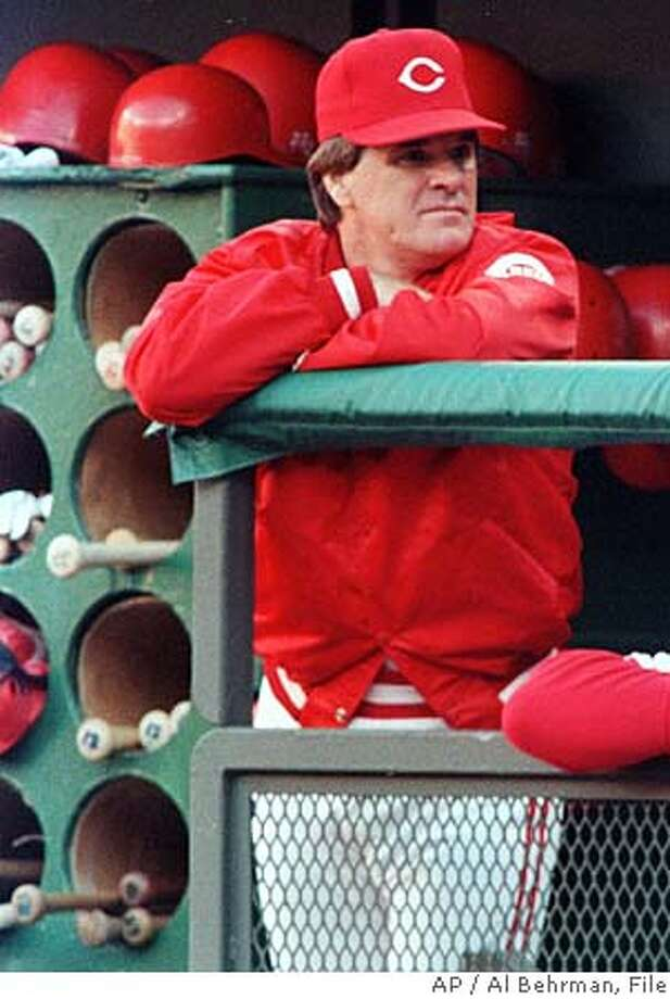 ** FILE ** Cincinnati Reds manager Pete Rose watches the action from the dugout at Riverfront Stadium in Cincinnati June 30, 1989. After 14 years of denials, Pete Rose has finally come clean and admitted he bet on baseball. Now he wants to know whether his confession will be good for anything more than his soul. Rose hopes baseball will end his lifetime ban after his first public acknowledgment that he bet on games while managing the Cincinnati Reds. He says he never bet against his own team.(AP Photo/Al Behrman) Pete Rose is baseball's career hits leader with 4,256. ProductName	Chronicle Sports#Sports#Chronicle#12/4/2004#ALL#5star##0421555803 Photo: AL BEHRMAN