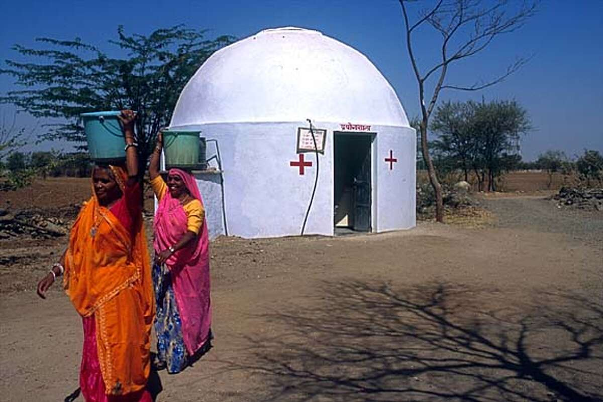 Another example of Barefoot Architects use of Buckminster Fuller's geodesic dome technology, this pathology lab covered in adobe is marked by red crosses, universally recognized as the symbol for first aid. Photo courtesy of the Aga Khan Award for Architecture
