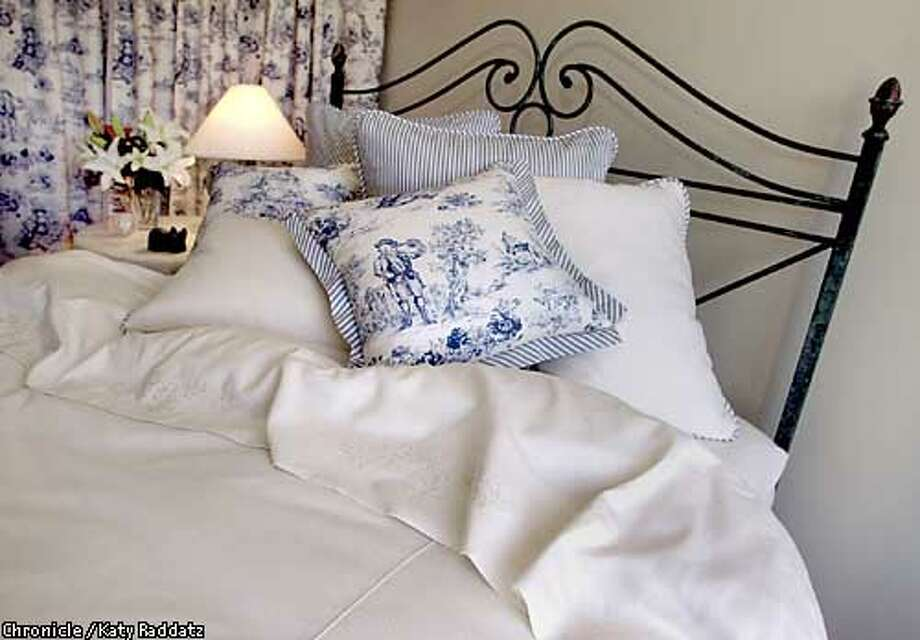 PHOTO BY KATY RADDATZ--THE CHRONICLE  Susan Veresh is producing her own line of fine thread count bed linens to be sold cheaply at Costco. SHOWN: A bed made up with her own linens. Photo: KATY RADDATZ