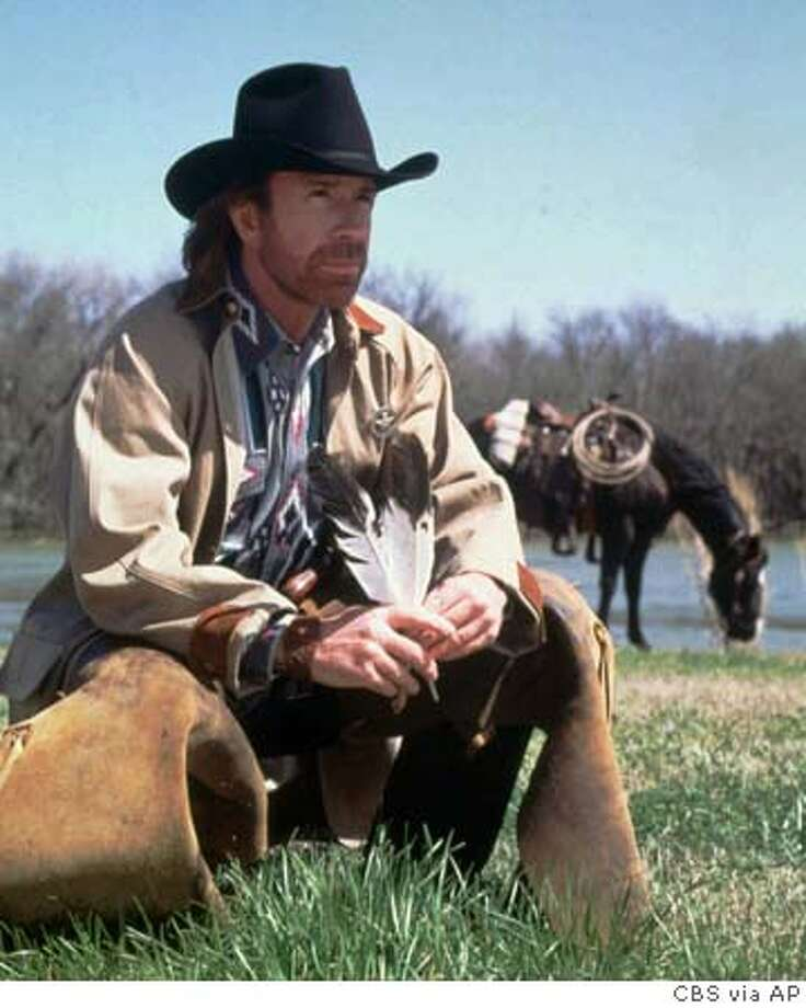 FILE--Chuck Norris, shown in character in a 1995 file photo, is fighting a copyright lawsuit. A judge has refused to toss out the suit alleging that the Texas Ranger portrayed by Norris in a 1983 movie and now in his CBS television series are essentially the same guy. In a ruling made public Wednesday, April 16, 1997, the judge said that a jury can decide whether CBS Inc., Top Kick Productions Inc. and Norris violated the copyright for the movie ``Lone Wolf McQuade'' belonging to Lone Wolf McQuade Associates. (AP Photo/CBS) 1995 HANDOUT PHOTO RealEstate#RealEstate#RealEstate#12/05/2004#ALL#Advance##421907532 Photo: TONY ESPARZA