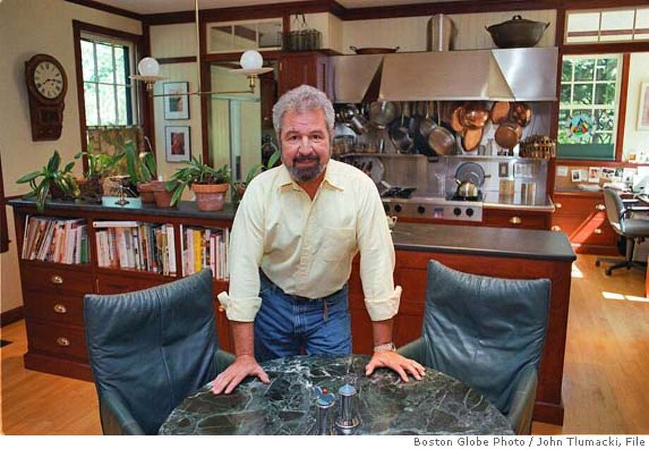 (NYT10) CAMBRIDGE, Mass. -- Oct. 08, 1998 -- HOME-VILA-BOS, 10-08 -- Bob Vila, in his kitchen, embarked on an unexpected career 20 years ago that has cast him as America's Handyman and launched him as a cottage industry. Despite TV's growing home-improvement industry, Vila, 52, remains the guy we think of when we think of a do-it-yourselfer up on a stepladder in just-bought Dockers and a Land's End shirt. (John Tlumacki/Boston Globe Photo) *LITE CAT Home&Garden#Home&Garden#Chronicle#12/4/2004##Advance##421994157 Photo: JOHN TLUMACKI