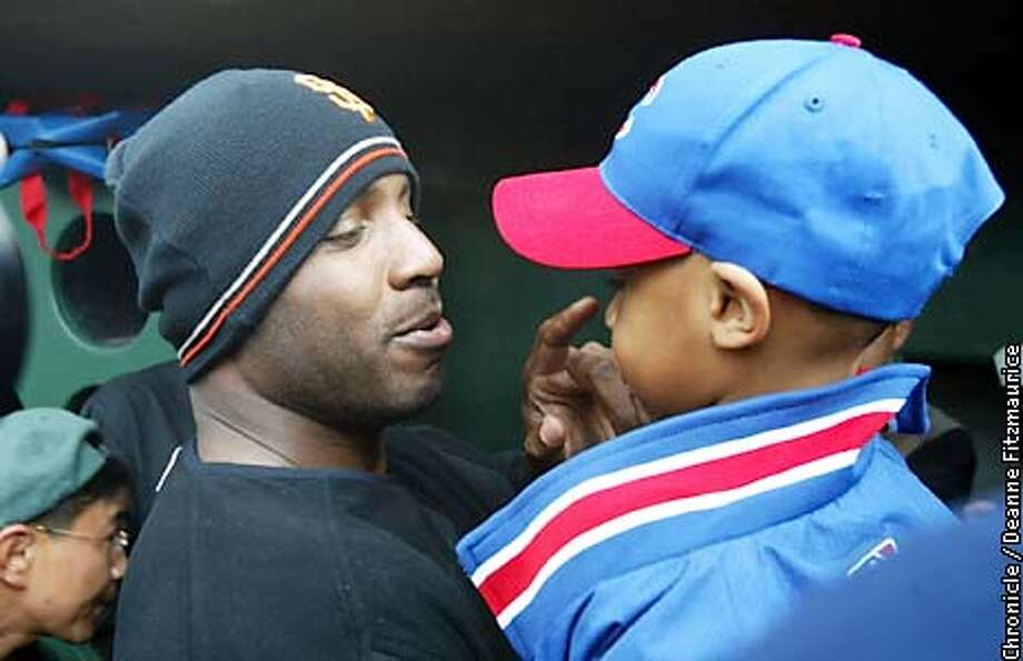 Barry Bonds greets Darren Baker and touches his nose. Dusty Baker brought his Chicago Cubs to Scottsdale Stadium to play his former team the San Francisco Giants for the first spring training game. The game was eventually called a rain out but not until after Baker was reunited with many of his former players and team personnel.  CHRONICLE PHOTO BY DEANNE FITZMAURICE Photo: Deanne Fitzmaurice