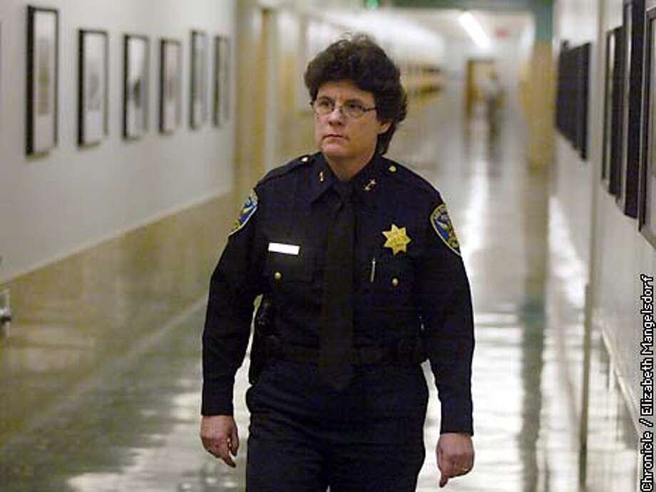 INDICTb-C-28FEB03-MN-LM  SFPD Deputy Chief Mindy Pengel walks past the office of the Police Chief in the Hall of Justice on the day the indictments came down in . Pengel was NOT indicted.  Photo by Liz Mangelsdorf