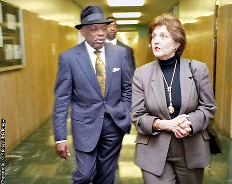 INDICTa-C-28FEB03-MT-MJM  Mayor Willie Brown arrives with assistant Eleanor Johns to the Police Comissioners meeting at the Hall of Justice to defend the Police Chief and top brass indicted by the Grand Jury.  SF CHRONICLE PHOTO BY MICHAEL Photo: MICHAEL MALONEY