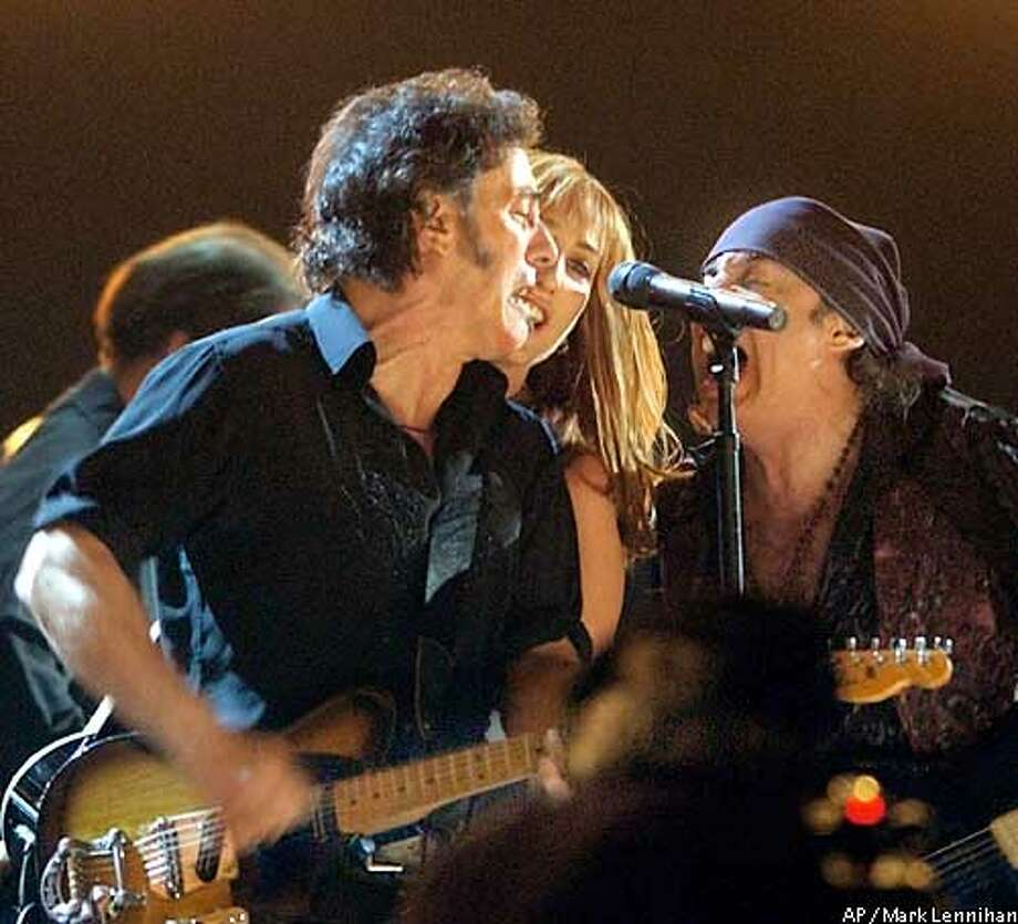 Bruce Springsteen and the E Street Band perform �The Rising� at the 45th Annual Grammy Awards on Sunday, Feb. 23, 2003, at Madison Square Garden in New York. (AP Photo/Mark Lennihan) Photo: MARK LENNIHAN