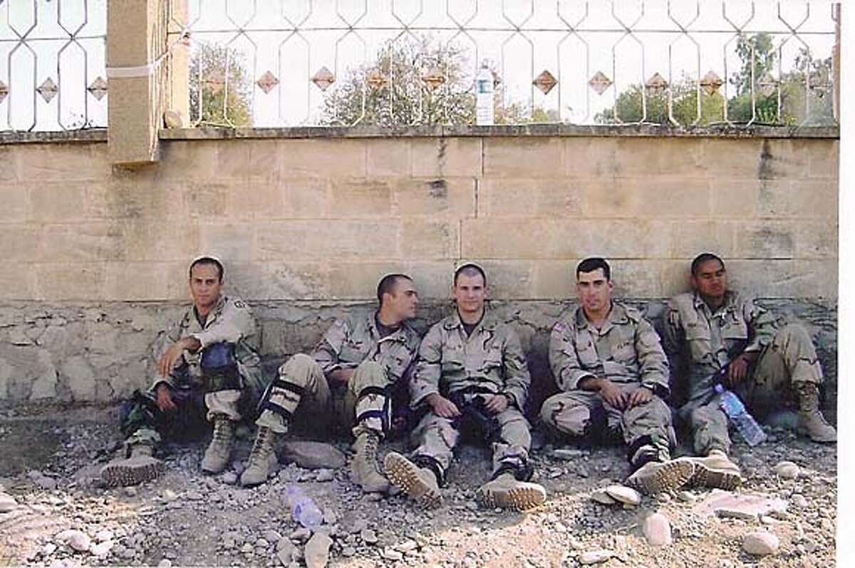 Photo of Emmet Howard, second from right, in Iraq.