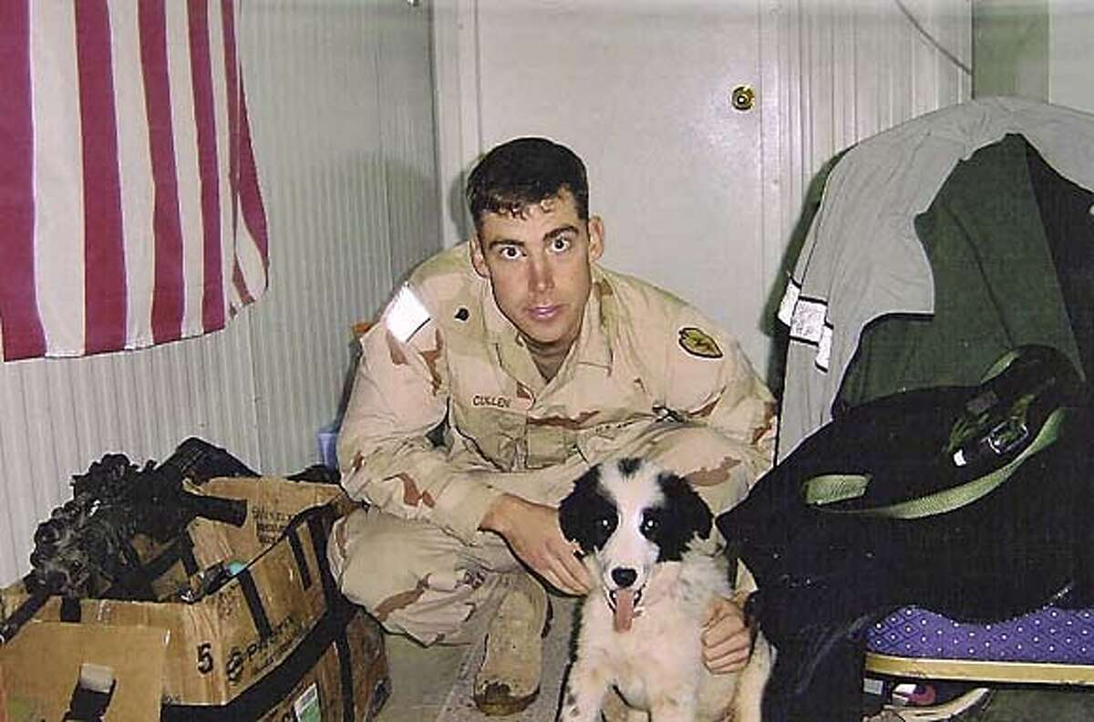Emmet Cullen at Forward Operating Base Freedom in Mosul last year with the dog the platton adopted.