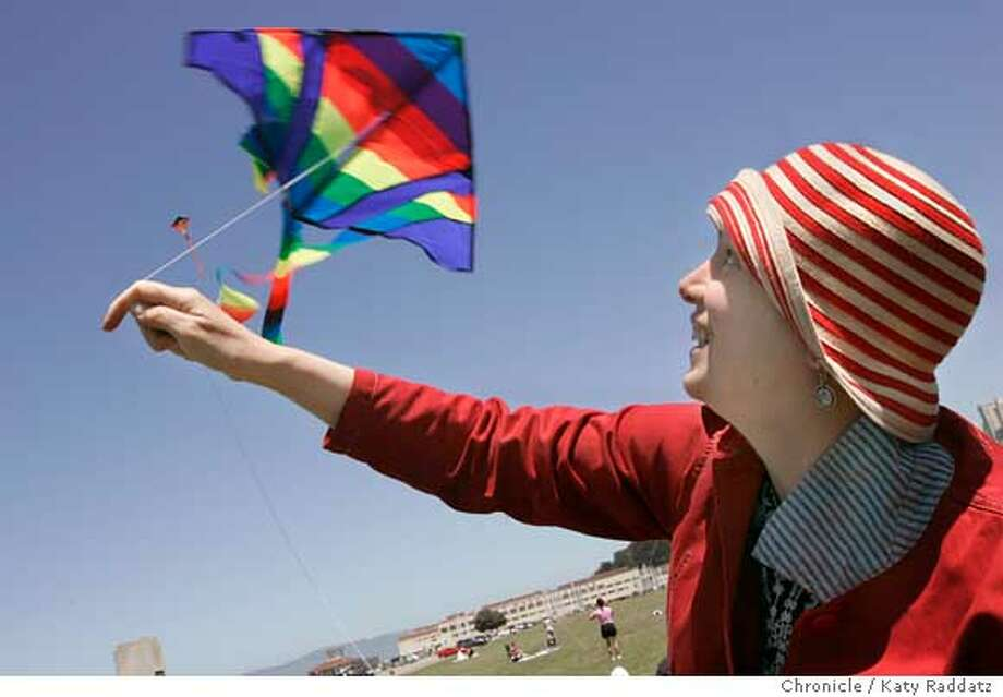 """This weekend people all over America and around the world will fly kites in solidarity with thousands of Israeli and Palestinian citizens who want peace and want to reach out to one another in an actin called 10,000 Kites--Talking Kites. SHOWN: In San Francisco, at the Marina Green, many people flew kites. Leila Abu-Saba, a Lebanese woman who lives in Oakland, (she wears striped hat), launches her son's kite. Leila said: """"So much of what divides us are walls and borders. Kites can fly above them.""""  Photo taken on 5/22/05, in SAN FRANCISCO, CA.  By Katy Raddatz / The San Francisco Chronicle Photo: Katy Raddatz"""