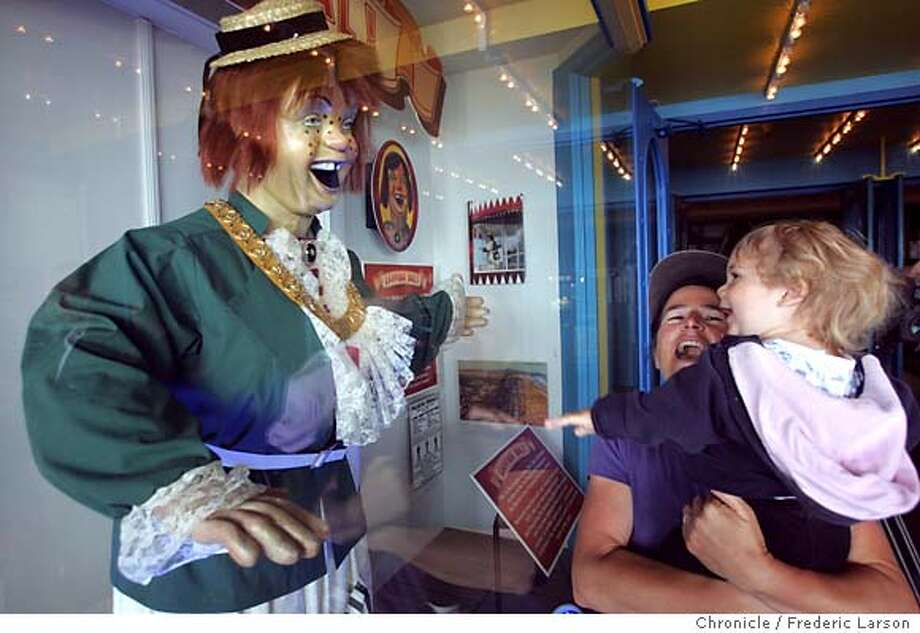 "SAL152_fl.jpg Laughing Sal, the mechanical woman and icon of the old Playland at the Beach amusement park in SF, was unveiled at her new home at Santa Cruz Beach Boardwalk where locals Joanna Manoff with her son Bailey (1) share in the laugh. Santa Cruz bigshots and the guy who installed new robotic guts into Sal's 80-year-old body and ""upgraded"" her famous cackle. This will officially kick off the Boardwalk's season. We will reinvestigate the ongoing controversy over whether this Laughing Sal is the ""real"" Laughing Sal (like Dorothy's ruby slippers, there was apparently more than one) and whether someone cut her head off, or something. 5/28/05 Santa Cruz CA Frederic Larson The San Francisco Chronicle Photo: Frederic Larson"