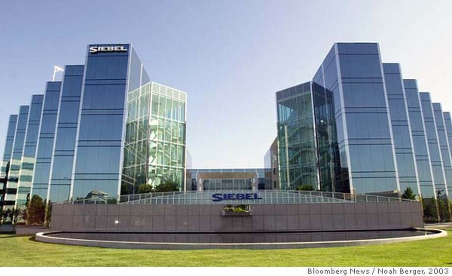 The headquarters building of Siebel Systems is seen in San Mateo, California on Thursday, July 3, 2003. Siebel Systems Inc., the world's largest maker of customer-service software, said second-quarter profit and sales fell more than forecast as customers spent less amid a ``turbulent'' business-software market and weak economy. Photographer: Noah Berger/Bloomberg News. Ran on: 04-14-2005  Siebel Systems, located in San Mateo, says first-quarter profit and sales on its customer service software are below expectations. Photo: Noah Berger