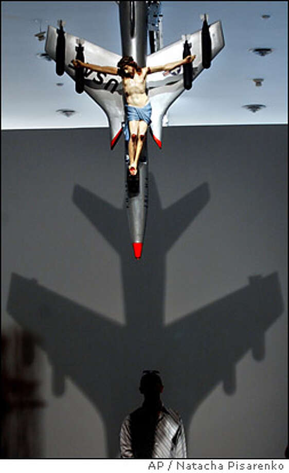 Argentine artist Leon Ferrari was known for works such as this figure of Christ crucified on a U.S. combat plane that often sparked controvery. Jorge Mario Bergoglio, before he became Pope Francis, tried to shut down an exhibit of his work. A judge agreed, but a different judge later overturned the decision.Source: Religion News Service Photo: NATACHA PISARENKO