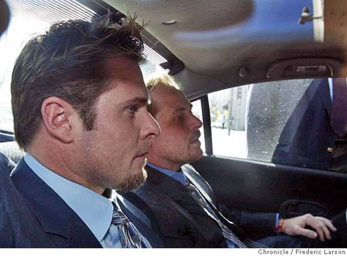 New York Yankees' Jason Giambi, front, and his brother Jeremy Giambi, who played with the Boston Red Sox in 2003, arrive at a federal building Thursday, Dec. 11, 2003, in San Francisco to testify before a grand jury in an investigation of a nutritional supplements lab.