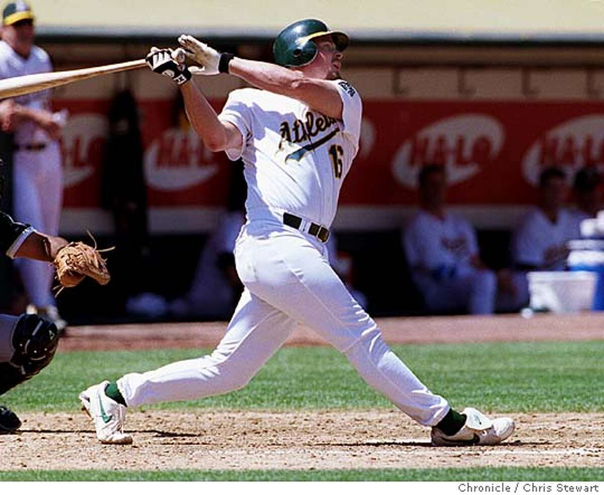 A'S-GIAMBI/C/19AUG98/SP/CS - The Oakland A's first baseman Jason Giambi singles in the fifth inning before being driven in by third baseman Mike Blowers when he hit a three run homer. The A's went on to win in a two hit shut out against the Chicago White Sox to beat them 6-0. BY CHRIS STEWART/THE CHRONICLE ALSO RAN: 04/02/1999 SPECIAL SPORTS SECTION / BASEBALL 1999 / OAKLAND A'S PREVIEW CAT Nation#MainNews#Chronicle#12/2/2004#ALL#5star##421987305