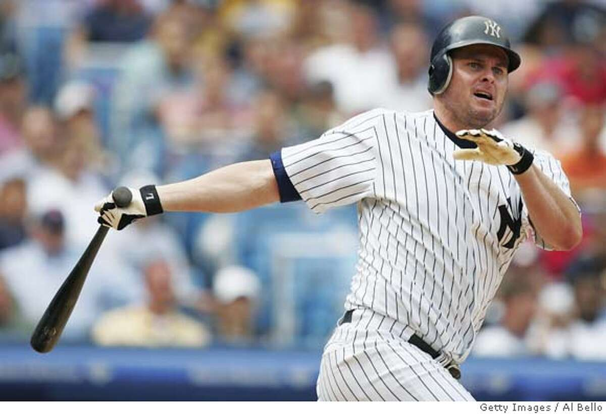 (FILE PHOTO) BRONX - JUNE10: Jason Giambi #25 of the New York Yankees watches a fly ball against the Colorado Rockies during their game on June 10, 2004 at Yankee Stadium in the Bronx, New York. The Yankees announced July 30 that Giambi has a benign tumor and is placed on the 15-day disabled list. (Photo by Al Bello/Getty Images) *** Local Caption *** Jason Giambi Ran on: 08-03-2004 Jason Giambi has a benign tumor and is on the disabled list as the As visit the Yankees this week. FILE PHOTO Nation#MainNews#Chronicle#12/2/2004#ALL#5star##0422230517
