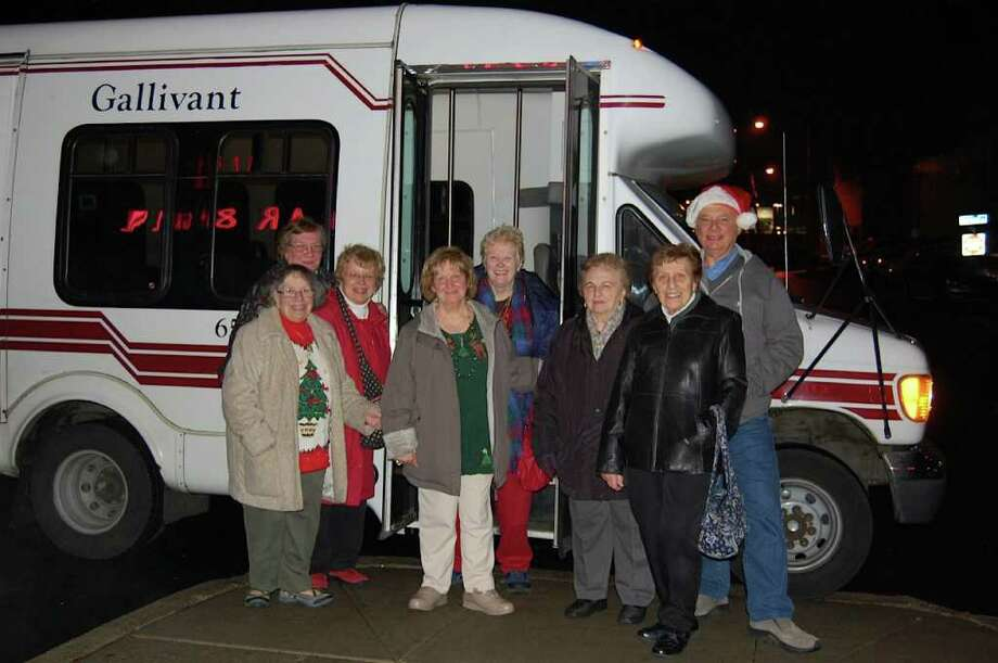 Rose Warren, volunteer aide Adrienne Perry, Cathy Oberle, Rose Geruso, Nancy Kapuse, Louise Landi, Rose Straight and Gallivant driver Rick Tymon pose for a photo after viewing holiday lights and enjoying coffee and dessert at a local diner. Photo: Contributed Photo