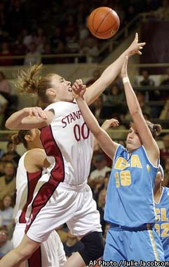 Stanford's Chelsea Trotter puts up a shot against UCLA's Whitney Jones during the first half Saturday, Feb. 22, 2003 in Stanford, Calif. Stanford won 79-61 and clinched the Pac-10 regular season conference championship. (AP Photo/Julie Jacobson) Photo: JULIE JACOBSON