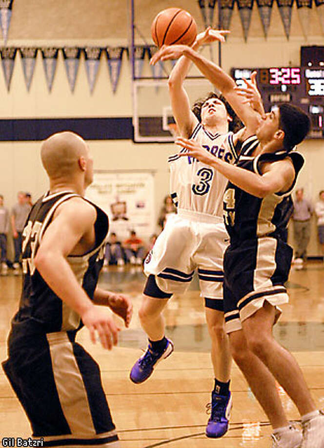 Mitty forward Paul Phangurah, right, swats away Andrew Kochevar's, center, shot as Mitty guard Stephen Chang looks for the rebound during Mitty's 63-56 WCAL Final victory over Junipero Serra on Saturday. Photo by Gil Batzri, special to SFGate.com