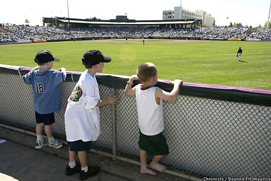 Young fans watch the San Francisco Giants players during spring training last year at Scottsdale Stadium in Scottsdale, Ariz. Chronicle photo by Deanne Fitzmaurice