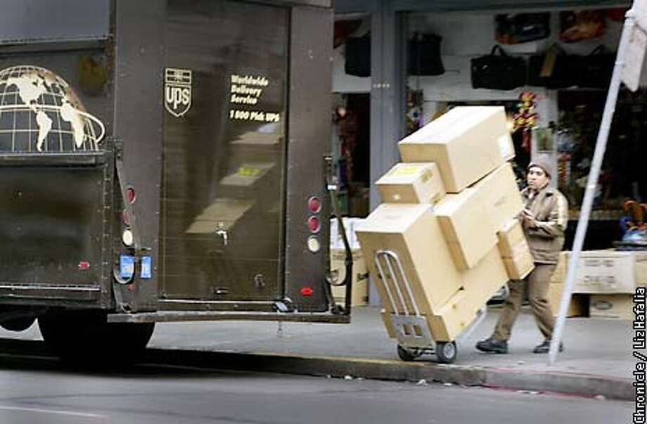 Manuel Pineda making a delivery to a sports store--2637 Mission St.. (PHOTOGRAPHED BY LIZ HAFALIA/THE SAN FRANCISCO CHRONICLE) Photo: LIZ HAFALIA