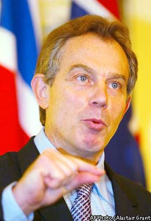 Britain's Prime Minister Tony Blair gestures at a news conference with his Australian counterpart John Howard, inside No. 10 Downing Street London, Thursday Feb. 13, 2003. The two Prime Ministers held talks on Iraq, on which Blair said that the discovery of extended-range missiles in Iraq could be a 'significant breach' of U.N. Security Council resolution 1441. (AP Photo / Alastair Grant, Pool) Photo: ALASTAIR GRANT